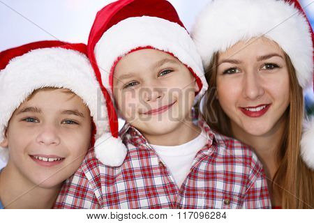 Portrait of girl and boys in decorated Christmas room, close up