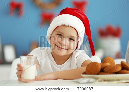 Portrait of cheerful boy in decorated Christmas room, close up