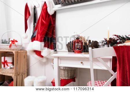 Santa costume hanging in white room