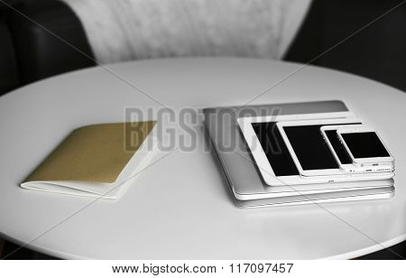 Pile of electronic gadgets on the table. Communication and technology concept