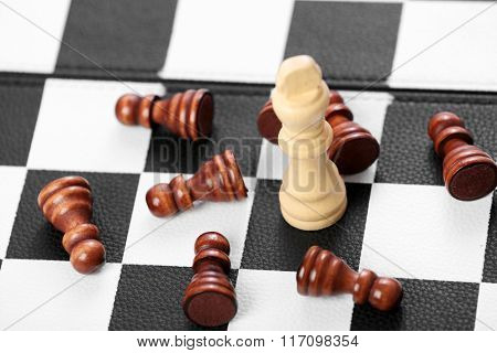 Chess pieces on game board background