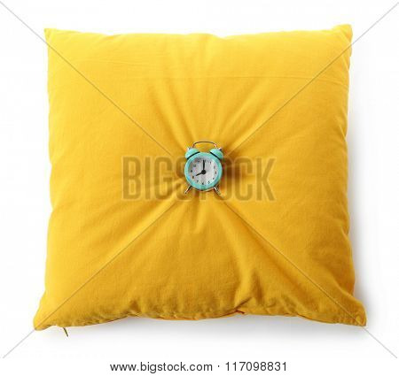 Alarm clock on pillow, isolated on white