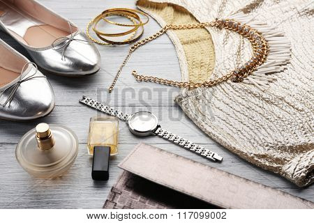 Composition of elegant woman\'s fashion look on wooden background, close up