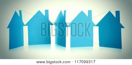 Paper houses on light background