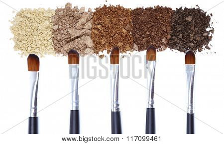Brushes and eye shadows isolated on white