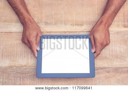 Overhead view of person holding on digital tablet