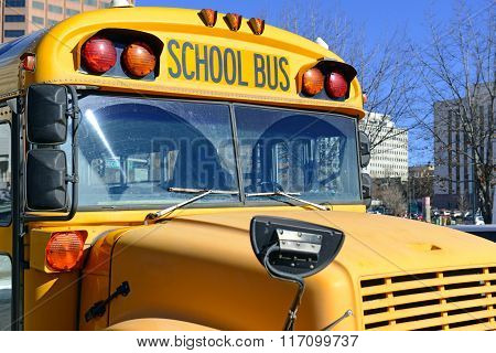 Front end of Yellow School Bus with grill and lights