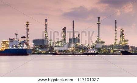 Oil refinery river front before sunrise