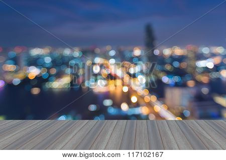Opening wooden floor, Abstract blurred bokeh light city aerial view night time