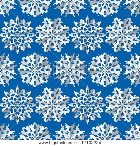 Seamless christmas pattern. Origami snowflakes signs. Paper white cut out silhouettes on blue backgr