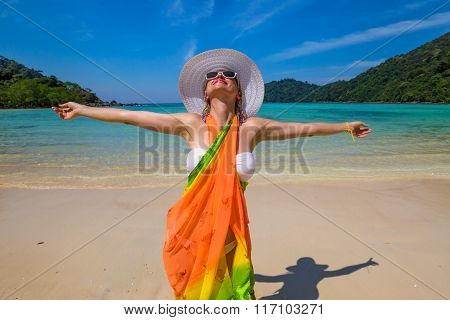 Happy woman on tropical beach