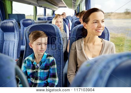 happy family riding in travel bus