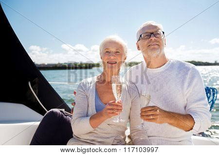 senior couple with glasses on sail boat or yacht