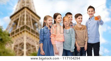 kids talking smartphone selfie over eiffel tower