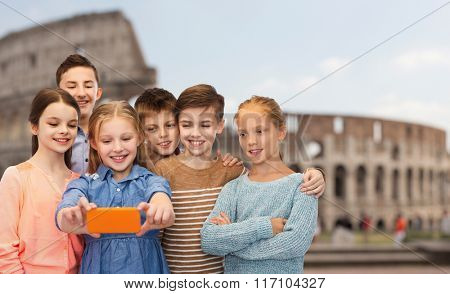 children talking smartphone selfie over coliseum