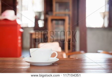 White Coffee Cup On Wooden Table