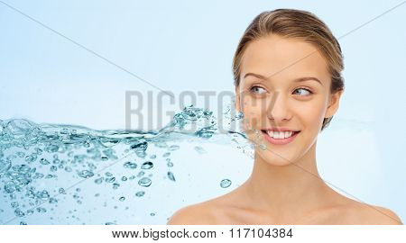 woman face and shoulders over water splash