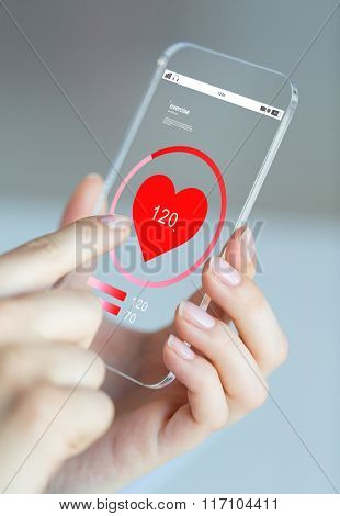 close up of hand with heart rate on smartphone