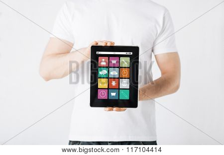 close up of man with app icons on tablet pc