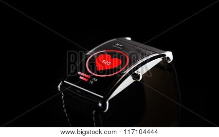close up of black smart watch with heart rate icon