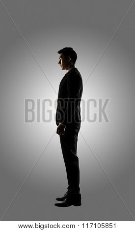 Confident businessman of Asian, silhouette portrait isolated