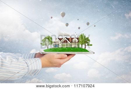 House model on tablet screen