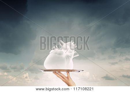 Human heart on tray