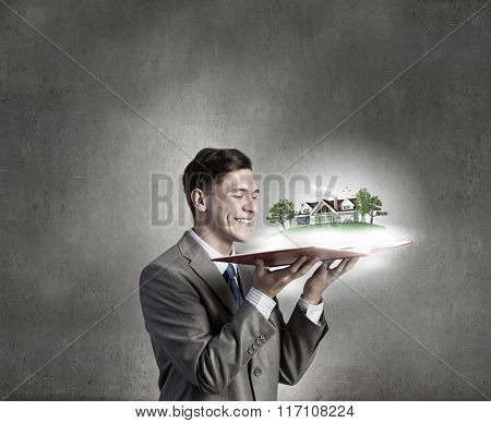 Businessman with opened book