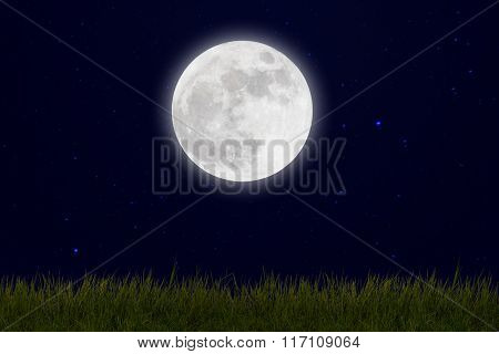 Full Moon With Stars And Field Of Green Hill On Darkness Sky.