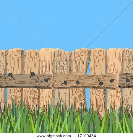 Wooden Fence And Blue Sky. Old Wooden Planks And Green Grass. Fence Of Wooden Board Stands On Green