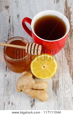 Fresh Lemon With Honey And Cup Of Tea On Wooden Table, Healthy Nutrition