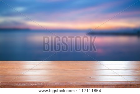 Old Empty Wooden Table Top With Sunset Background