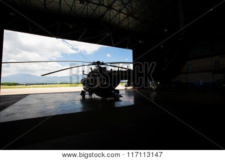Silhouette Of A Helicopter In The Hangar