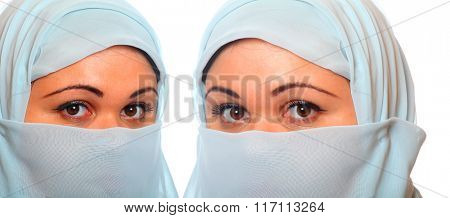 Young muslim woman with hide face. Studio portrait on white background.