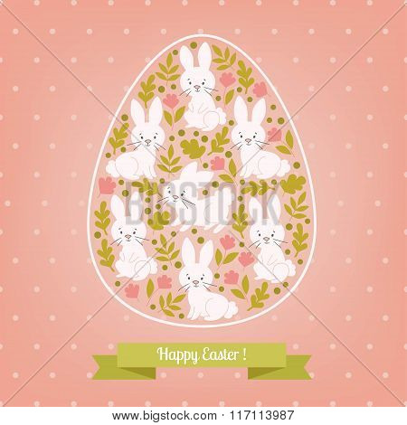 Greeting card white Easter rabbit in the egg.