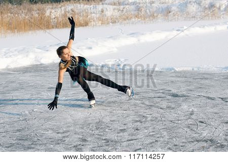 young Figure skating woman at the frozen lake