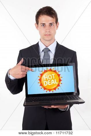 Business Man Pointing At A Colorful Sale Label 1