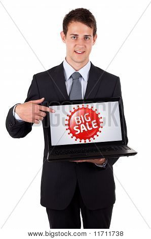Business Man Pointing At A Colorful Sale Label 3
