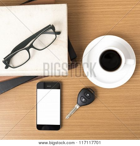 Coffee,phone,car Key,eyeglasses And Stack Of Book