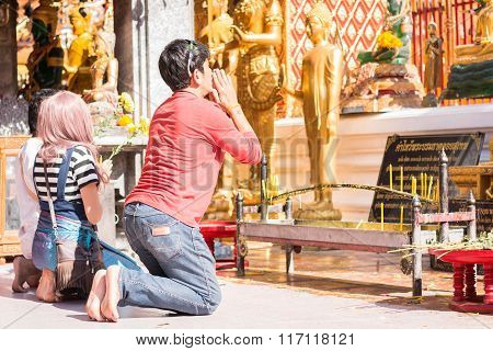 Chinese tourist pray for endless happiness and health