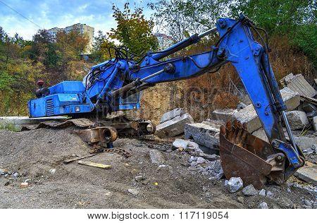 Broken Excavator On A Dump
