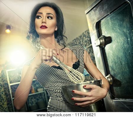 Beautiful brunette mixing ingredients in a bowl. Sensual slim young woman with black bra