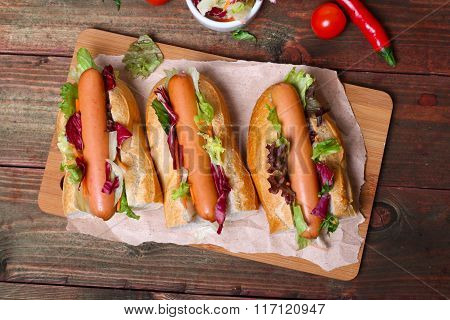 home made Hot dog - sandwich with lettuce on wooden background
