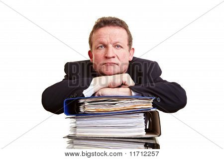 Senior Business Man With Stack Of Files