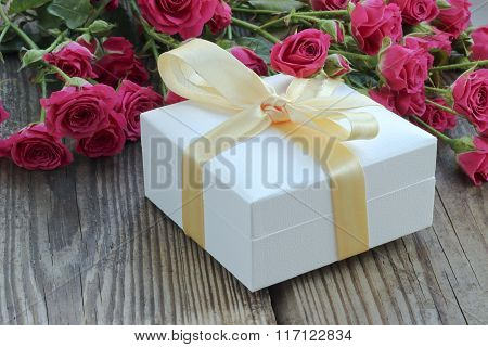 Holiday Background With Pink Roses And Gift Box
