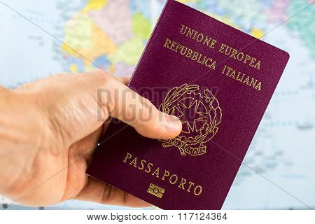 Hand Holds An Italian Passport