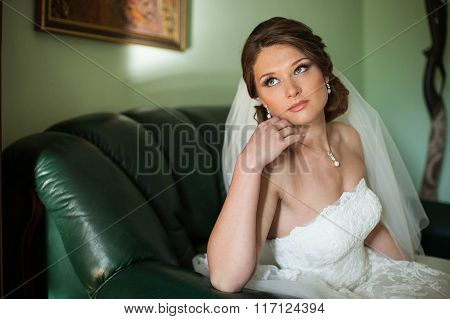 Elegant Pretty Charming Bride Poses For A Photo On The Couch