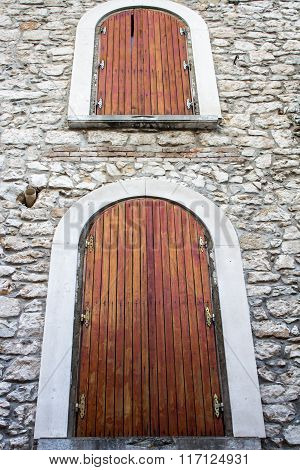 Two Wooden Window In A Stone House