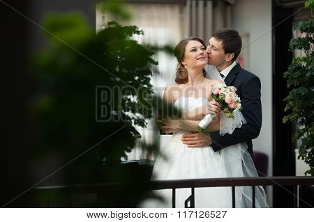 Elegant Masculine Young Groom Kissing On The Stairs