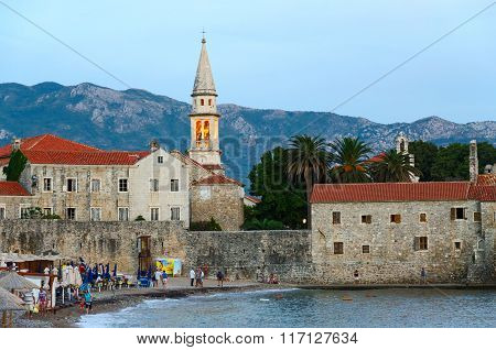 Evening View Of The Beach And The Old Town Of Budva, Montenegro